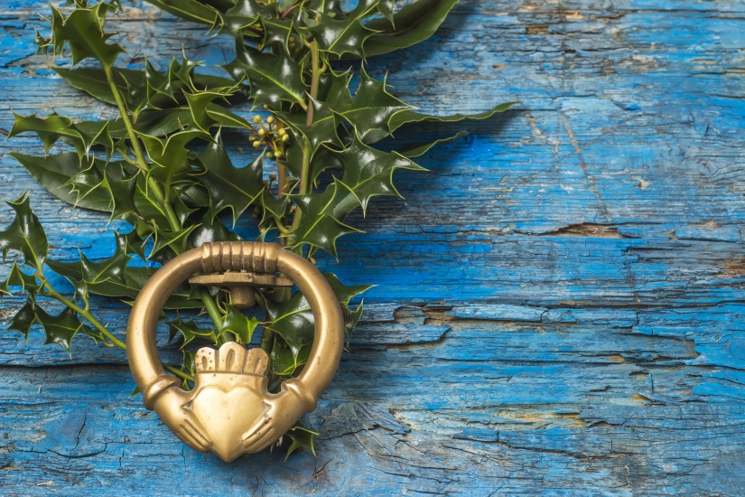 Claddagh and holly branches irish symbol of love
